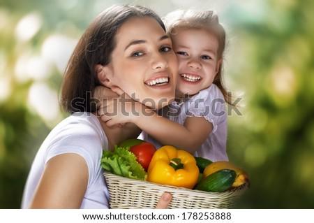 happy family keeps fresh vegetables - stock photo