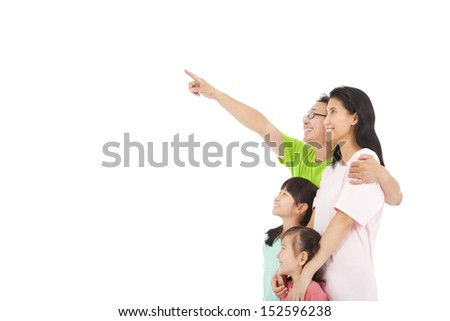 Happy family looking and pointing