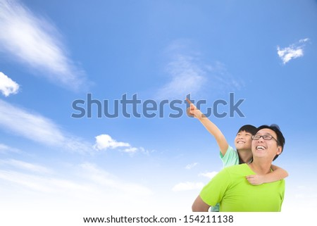 Happy family looking and pointing with cloud background - stock photo