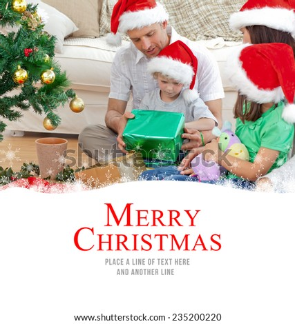Happy family looking at the little boy opening a christmas present against merry christmas - stock photo