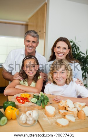 Happy family making sandwiches together