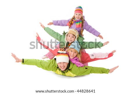 Happy family members lying with their arms stretched