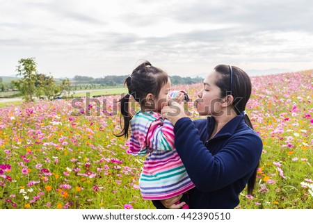 Happy family moments at flower garden
