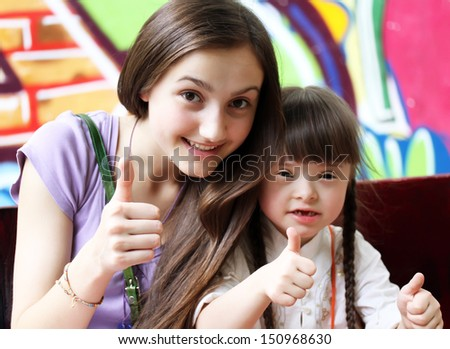 Happy family moments giving thumbs up. - stock photo