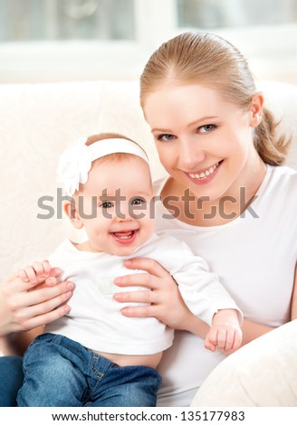 happy family. Mother and baby daughter at home on the sofa at home