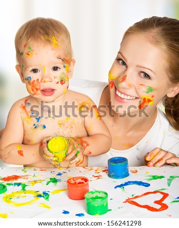 happy family mother and baby paint colors hands dirty - stock photo