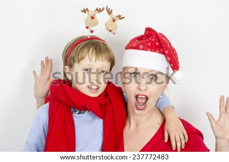 happy family mother and boy in red Christmas hats