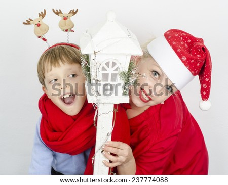 happy family mother and boy in red Christmas hats  - stock photo