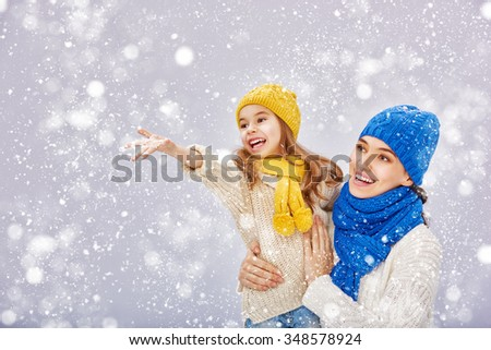 Happy family! Mother and child girl on a winter walk. - stock photo