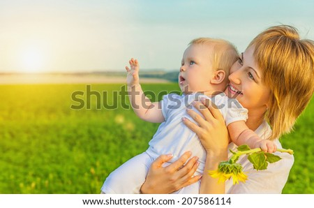 Happy family. Mother and child playing in nature - stock photo