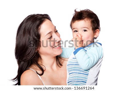 Happy family mother and cute son sucking thumb, isolated. - stock photo