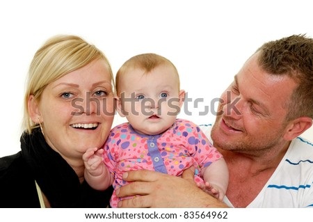 Happy family. Mother and father are looking at their sweet smiling 4 month old baby.