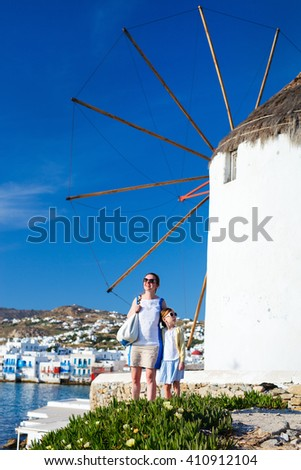 Happy family mother and her adorable little daughter on vacation at Mykonos island, Greece - stock photo