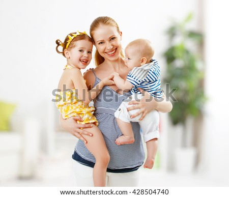 happy family mother and her children daughter and son - stock photo