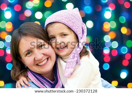 happy family mother and  little daughter hugging  in the winter for the Christmas holidays  - stock photo