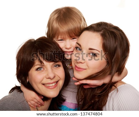 Happy family, mother and two daughters, a teenager and a toddler. Isolated on white background - stock photo