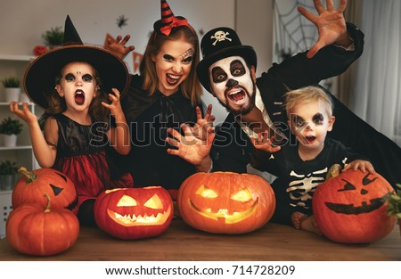 https://thumb1.shutterstock.com/display_pic_with_logo/874096/714728209/stock-photo-happy-family-mother-father-and-children-in-costumes-and-makeup-on-a-celebration-of-halloween-714728209.jpg