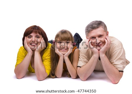Happy family. Mother, father and little daughter are smiling . Woman, man and girl are lying on the floor and posing happily on white background. - stock photo