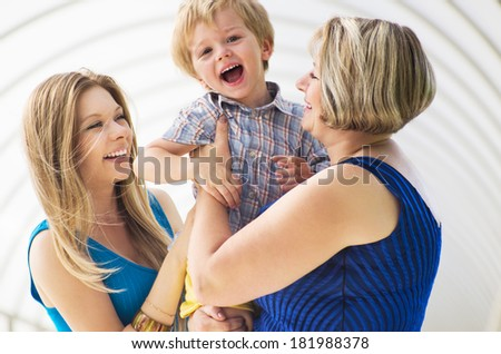 Happy family.Mother, grandmother and little boy. - stock photo
