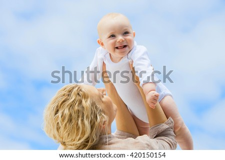 Happy family, mother holding baby - stock photo