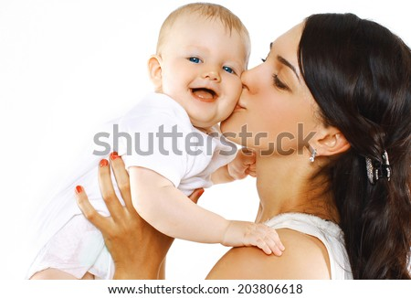 Happy family mother kissing baby - stock photo