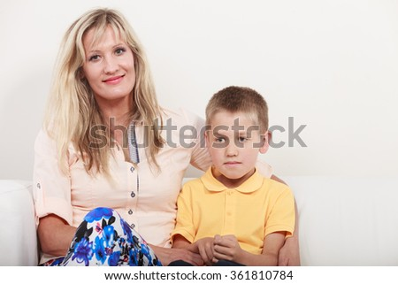 Happy family. Mother mom woman and kid little boy son on sofa couch at home. - stock photo