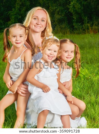 happy family. mother of many children and three daughters child girl summer outdoors - stock photo