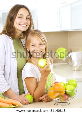 Happy Family Mother with her Daughter eating Healthy food. Diet. Healthy Eating Concept - stock photo
