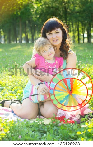 Happy family mother with her daughter in nature - stock photo