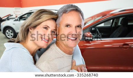 Happy family near new car. Auto dealership and rental concept background. - stock photo