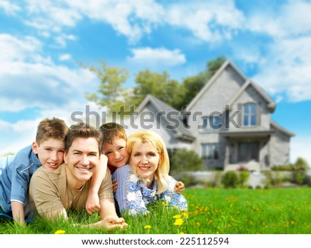 Happy family near new home. Mortgage concept. - stock photo