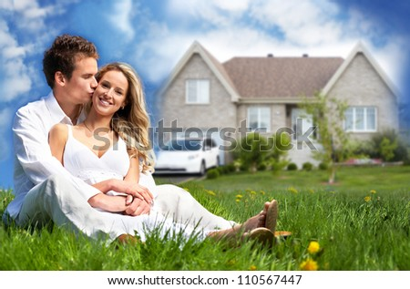 Happy family near new house. Real estate concept.