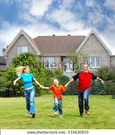 Happy family near new house. Real estate concept. - stock photo