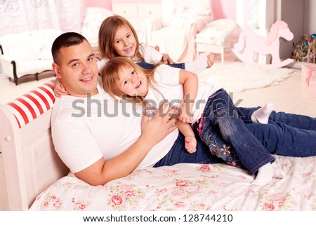 Happy family nice and smiling at home - stock photo