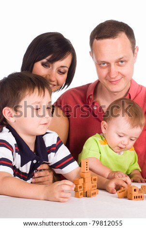 happy family of a four playing on white