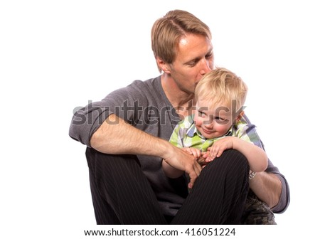 Happy family of father embracing his son smiling looking at camera isolated on white background waist up with copy place - stock photo