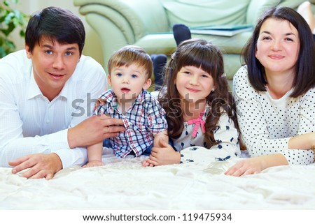happy family of four persons at home - stock photo