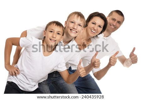 Happy family of four showing thumbs up on white background - stock photo