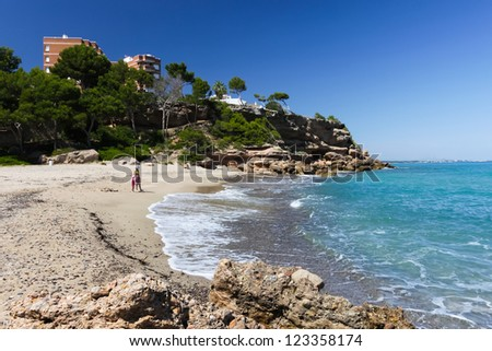 happy family of kid and mother on the sea beach - stock photo