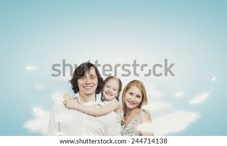 Happy family of mother father and daughter sitting on cloud - stock photo