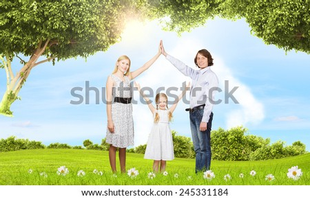 Happy family of three dreaming about home - stock photo