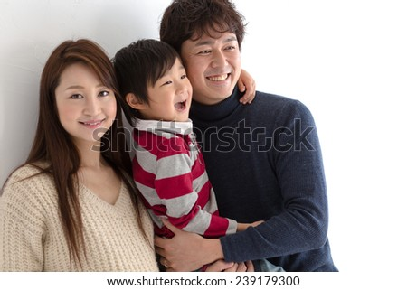 Happy family of three (focus on the father) - stock photo