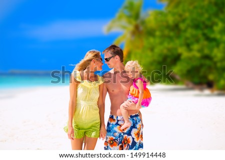 Happy family of three having tropical vacation on Maldives - stock photo