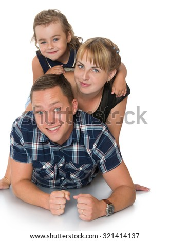 Happy family of three lying on the floor. Mom, dad and little charming daughter-Isolated on white background
