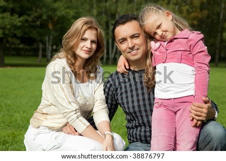 happy family of three outdoors - stock photo