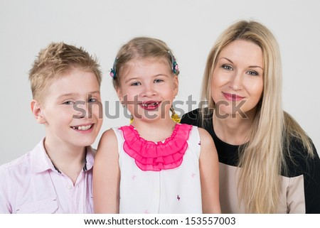 Happy family of three people in the studio
