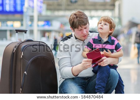 Happy family of two: Father and little son at the airport, traveling together. - stock photo