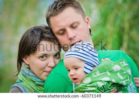 Happy family on a green background - stock photo