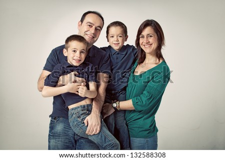 Happy Family on a Grey Background - stock photo