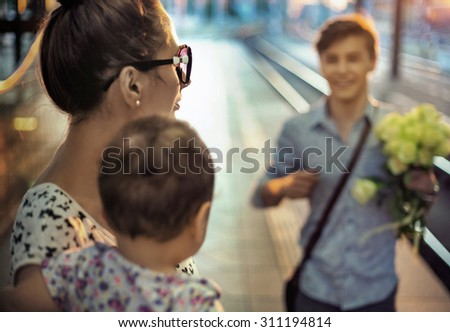 Happy family on a rail station - stock photo